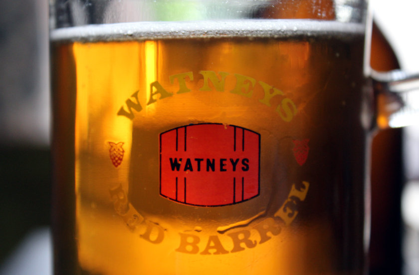Watney's Red Barrel: beer in vintage glass with logo.