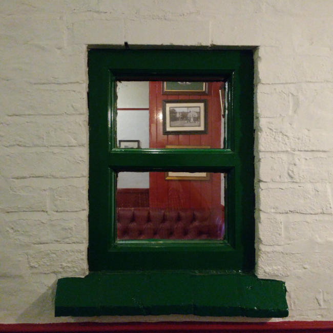 An interior window at the Old Swan.