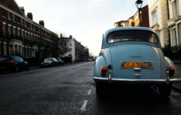 A morris minor in a city street.