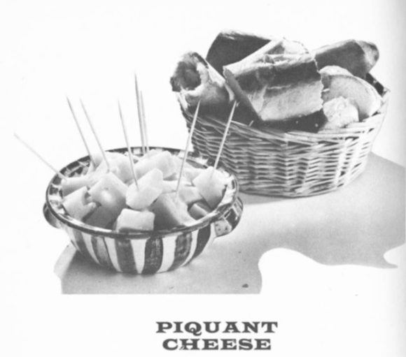 'Piquant Cheese' -- a bowl of cheese nibbles and a basket of bread.