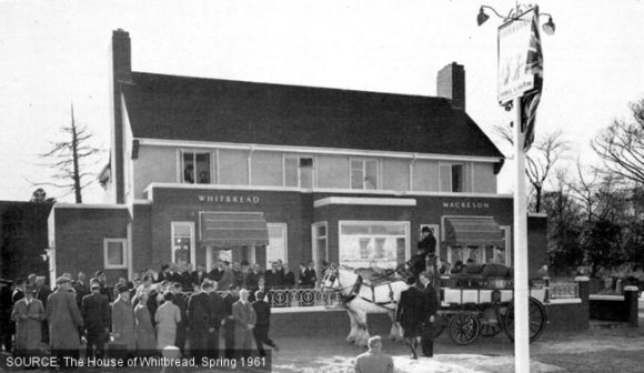 The exterior of the Horse & Groom with horse-drawn carriage.