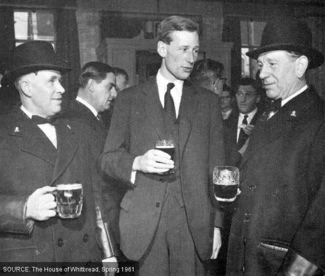 Three men drinking beer, two in bowler hats.