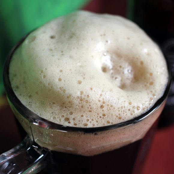 The head (foam) on a glass of Avena Stout.