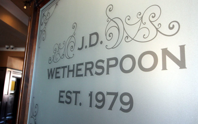 "Wetherspoon's engraved glass ""Est 1979""."