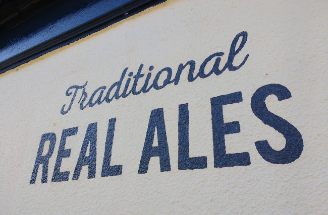 """Sign: """"Traditional Real Ales""""."""