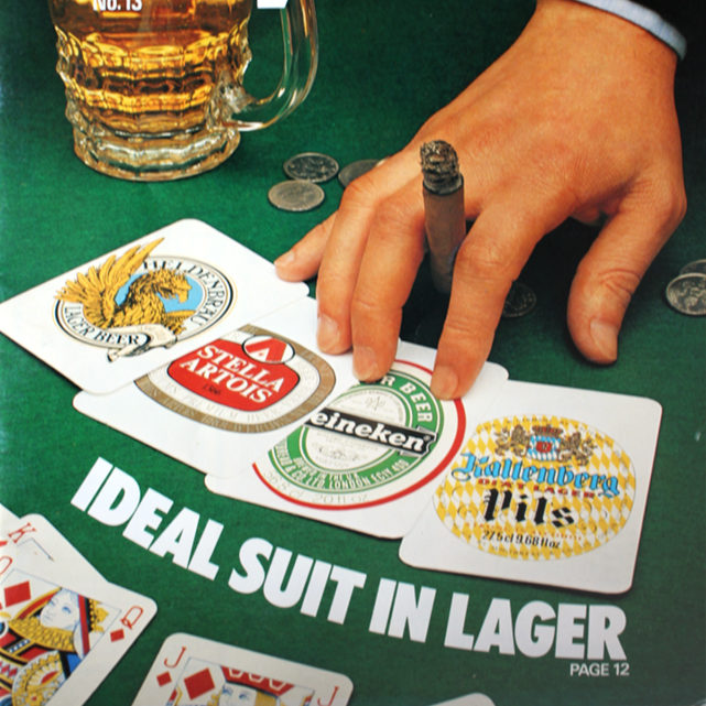 """Ideal Suit in Lager"" -- a hand with playing cards depicting lager brands."