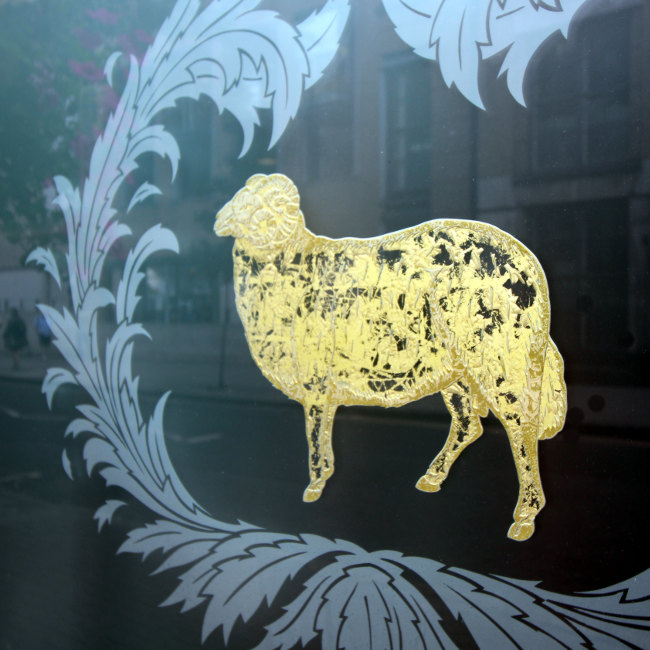 The Young's brewery ram mascot on a London pub window.