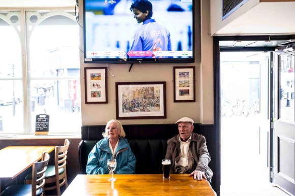 Two elderly drinkers in a London pub.