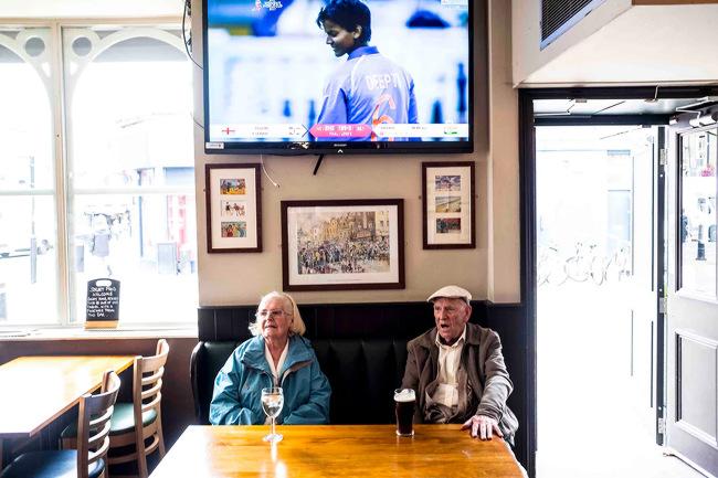 Two elderly drinkers in a London pub.