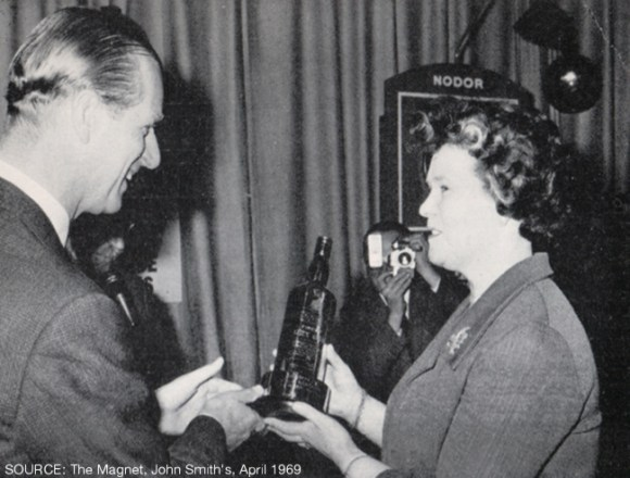 The Duke of Edinburgh presenting Mrs Land with her trophy.