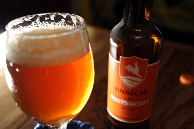 Kinnegar Rustbucket glowing in its glass.