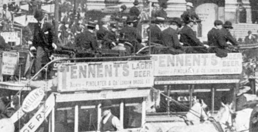 Close up of omnibuses advertising Tennent's Lager