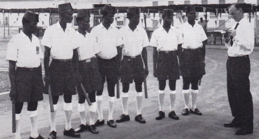 Uniformed men in a row.