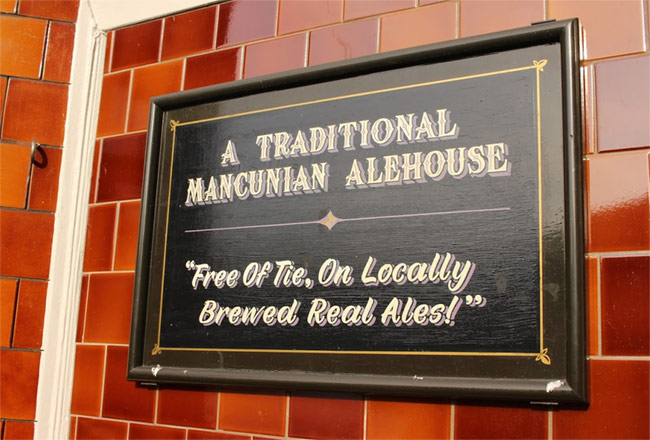 "Sign: ""A Traditional Mancunian Alehouse""."