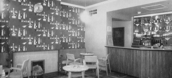 A view of the same bar with typically 1950s wallpaper.