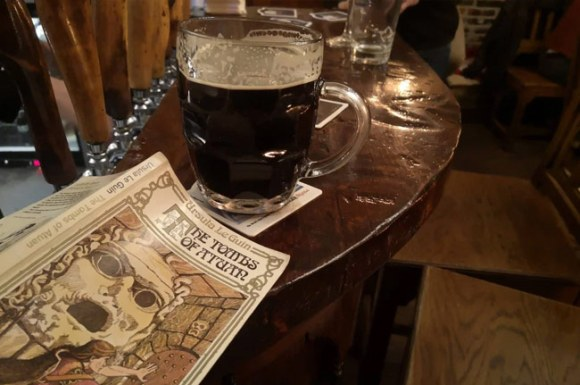 A pint and a book.
