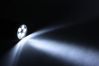 Beam from flashlight closeup on paper