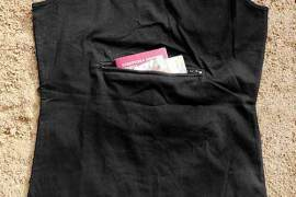 Pickpocket proof clothes: Clever Travel Companion's black tank; safest place to carry money
