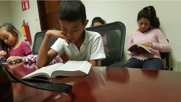 Migrant children receive the Word of God
