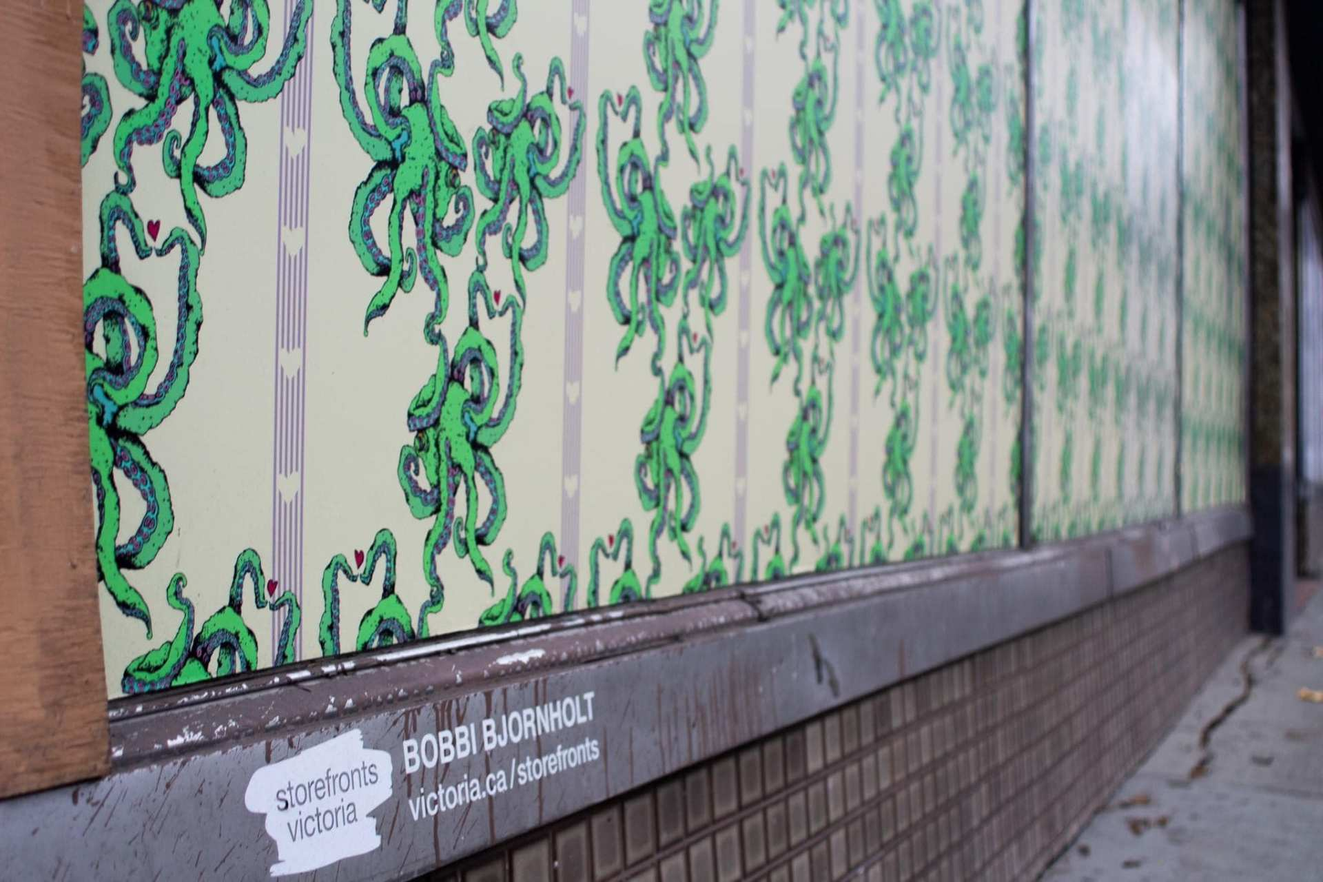 closeup of an image of green octopus on a store window