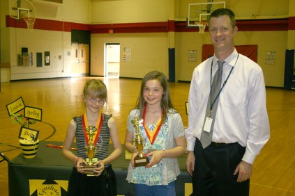 Spelling bee champions Jade Tesar (left) and Jillian Lang with Principal Ralph Bryant.
