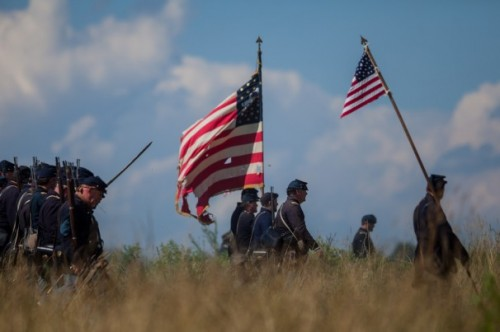Reenactors participate in a demonstration during the 150th anniversary of the Battle of Gettysburg, Saturday, June 29, 2013, in Gettysburg, Pa. (AP Photo/Richmond Times Dispatch, Zach Gibson)