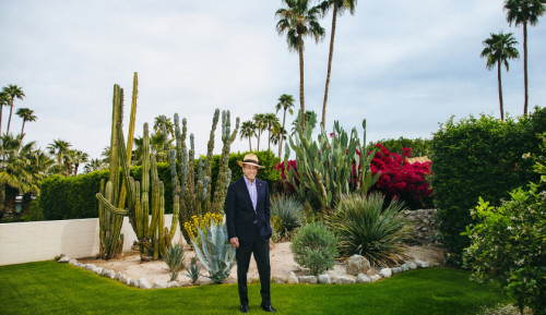 Isadore Sharpe, founder and chairman of the Four Seasons Hotels and Resorts, poses for a portrait at his home in Palm Springs, California, March 11, 2016. Photo by Kendrick Brinson