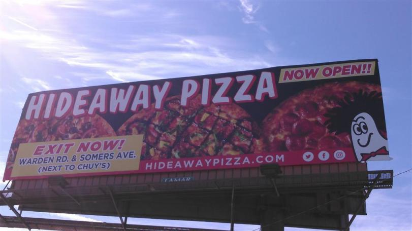 Billboard for opening of Hideaway Pizza in North LIttle Rock Arkansas - Design by Bob Paltrow, Bellingham WA