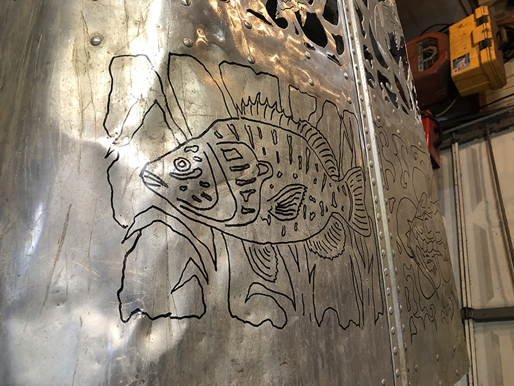 Hand drawn freshwater fish by Bob Parker before cutting out of metal canoe.
