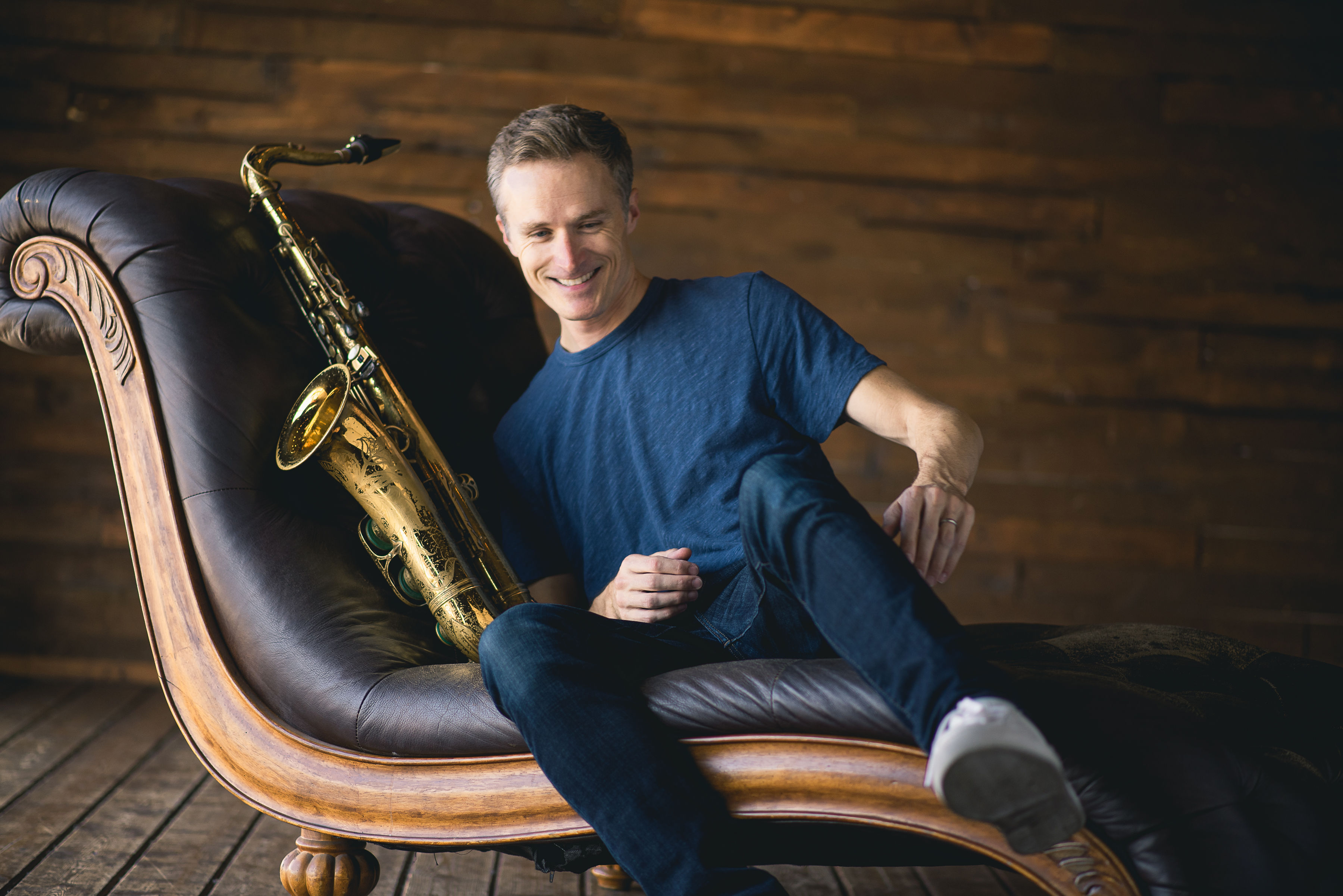Saxophonist Bob Reynolds on a couch