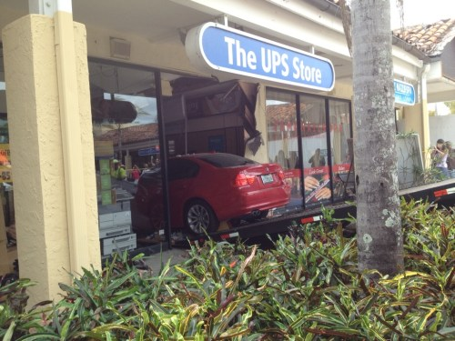 Car into Boca ups store