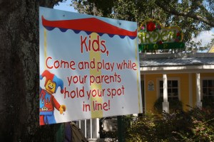 Legoland Florida gets it right. Kids can play while parents hold their space in line.