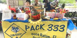 Group Photo of Cub Scouts at table in Boca Raton
