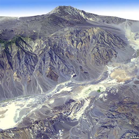 An image of Death Valley - the lowest, driest, and hottest location in North America - composed of a simulated natural color image overlayed with digital topography data from the ASTER Global Digital Elevation Model.