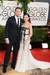 Channing Tatum arrived in a Gucci suit, while Jenna Dewan wore a gown by Roberto Cavalli