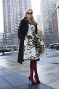 Irina Bass in a Carolina Herrera dress, Oscar de la Renta coat and Charlotte Olympia shoes