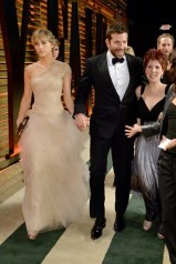 Suki Waterhouse - in a Marchesa gown with Harry Winston diamonds - and Bradley Cooper.