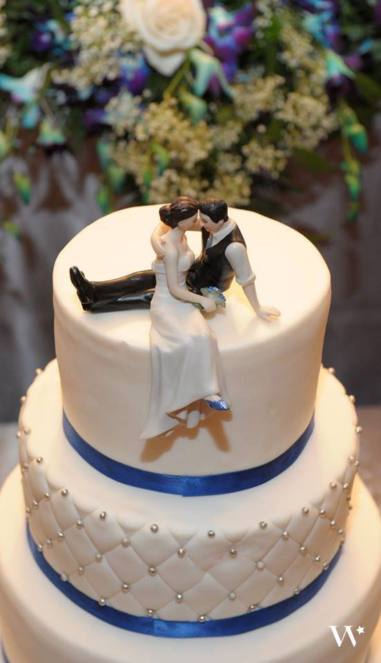 The Complete Guide to Wedding Cake Toppers  Unique Ideas   Tips Caught sneaking a kiss this laid back couple takes a moment for romance   Hand