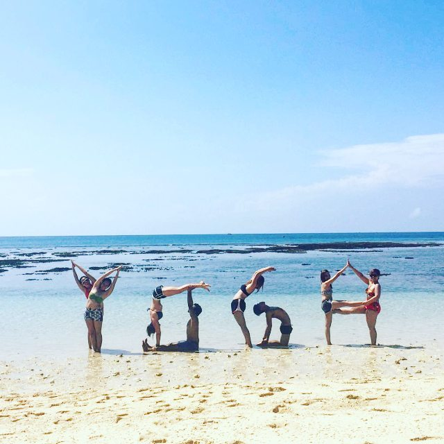 Performing Acro-Yoga at Sarangani white sand Beach (Yoga Teacher Training in Philippines)