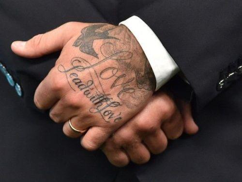 Roman Numeral Spine Tattoo Men