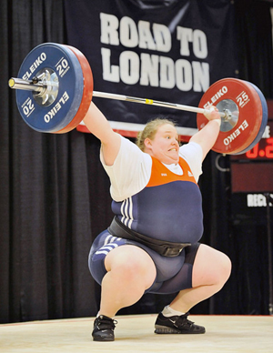 Image of Holly Mangold, a fat female athlete and olympic hopeful, snatching 110 kilos