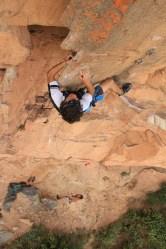 Sebastian on the crux of La Vaca Loca 5.11a