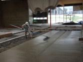 CEO Jack Lamb finishing concrete