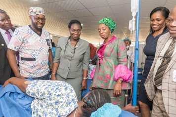 BOF with Gov's Wife visiting healing patient
