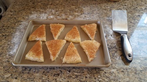 Put the sheet of scone dough into the oven at 450 for 12-15 minutes, or until an inserted toothpick comes out clean.