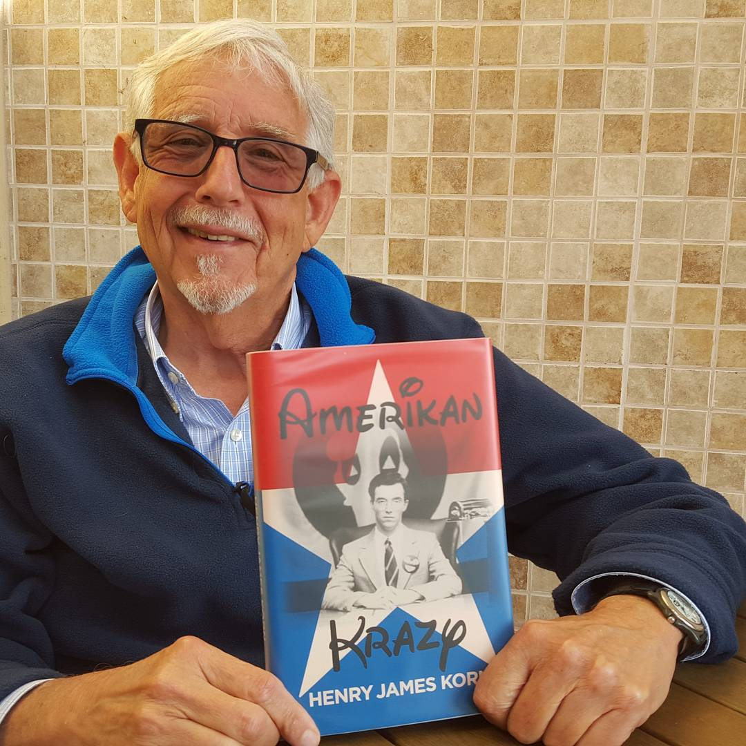 Henry Korn holding the very first copy of Amerikan Krazy