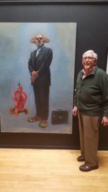 "Henry Korn poses with a ""Corporate Clown"""