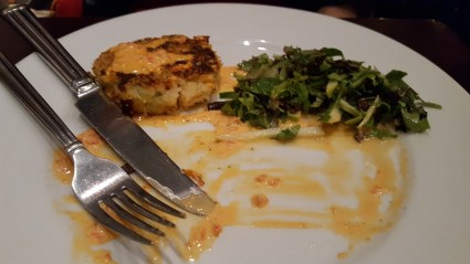 Cakebread Crab Cakes: Lump and blue crab, red pepper aioli, granny smith apple salad, Champagne vinaigrette.