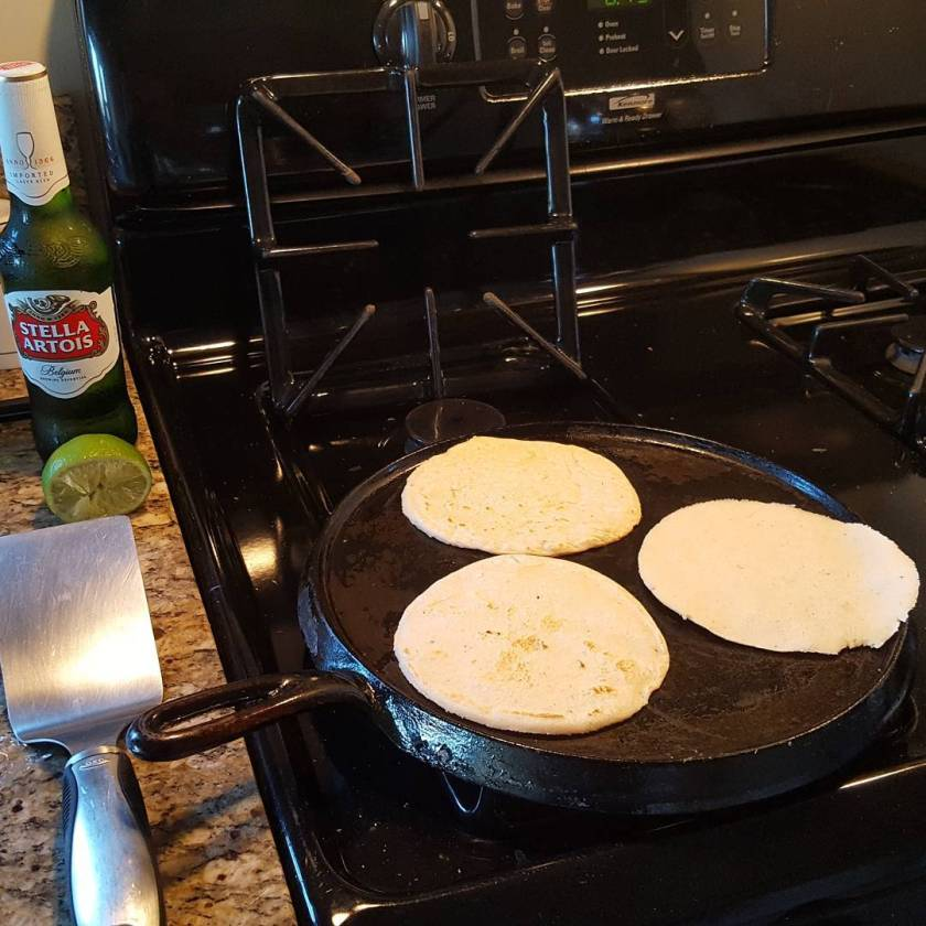 Fresh handmade corn tortillas cooking on the comal for dinner.