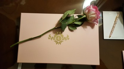 A rose in the room with stationery